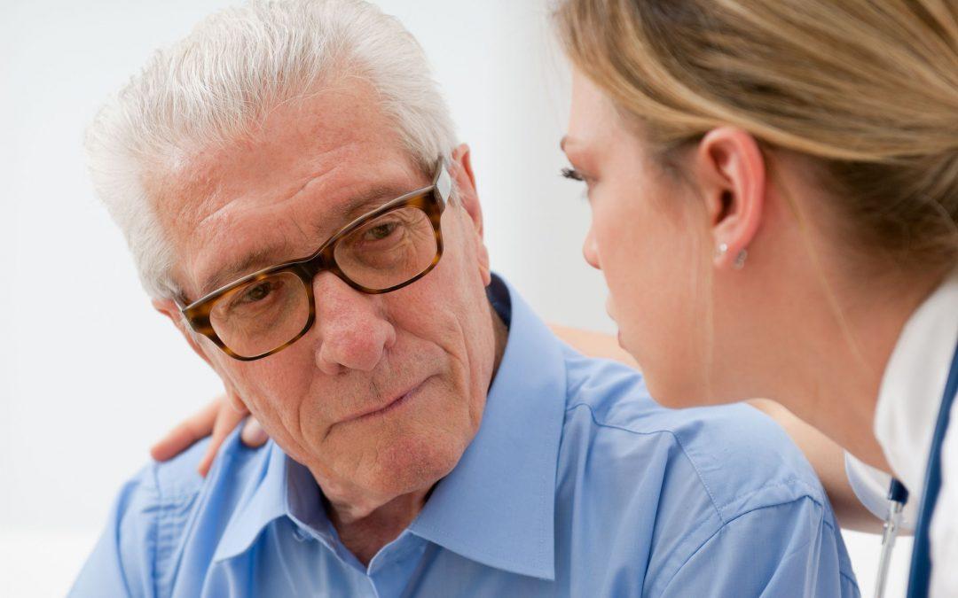 Eye doctor examining older man