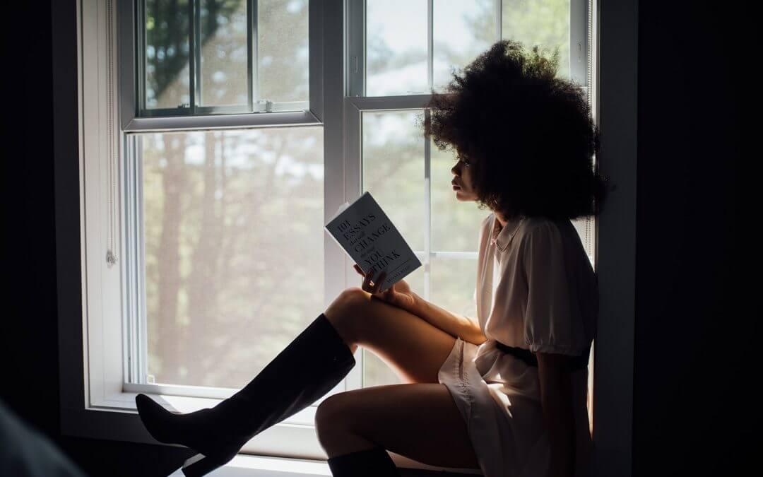 Woman in window reading book